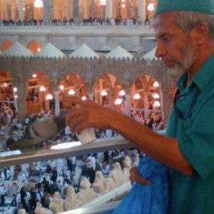 Muslim-Feeding-Pigeon