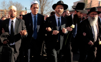 Jewish and Muslim leaders link arms in silent march to honour victims of shooting at Ozar Hatorah school in Toulouse